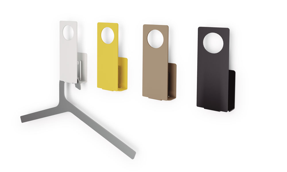 Buraco. Wall hangers made of folded and painted steel sheet