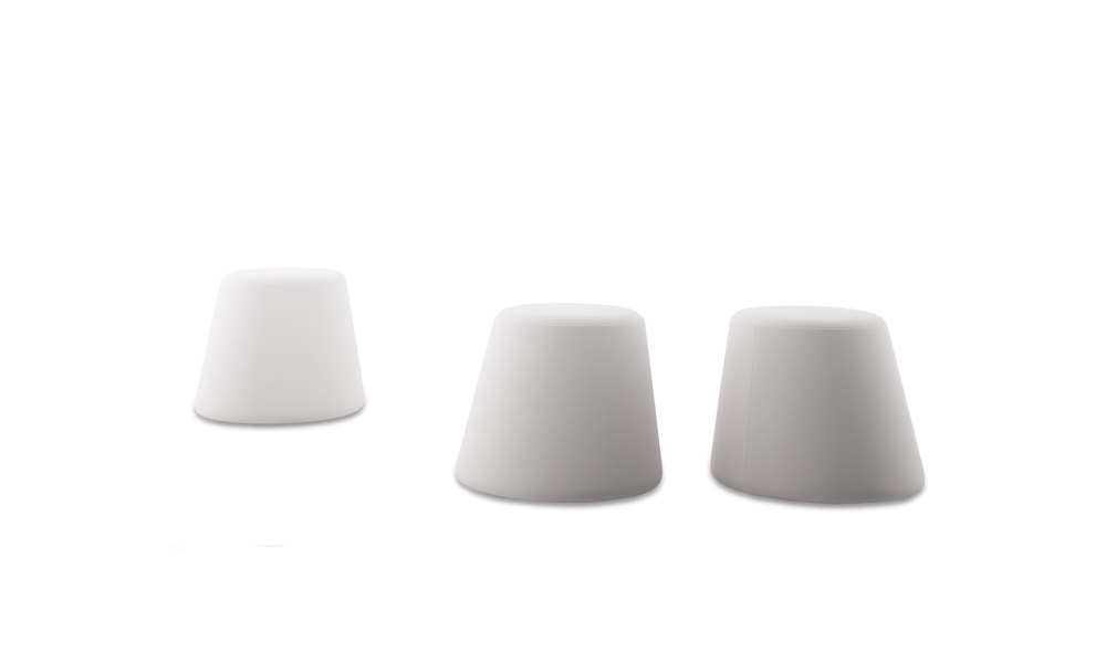 Conee Pouf. Has a wooden cone trunk structure with a bent axis